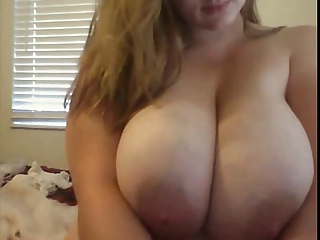 BBW Teen with huge boobs puts on a show